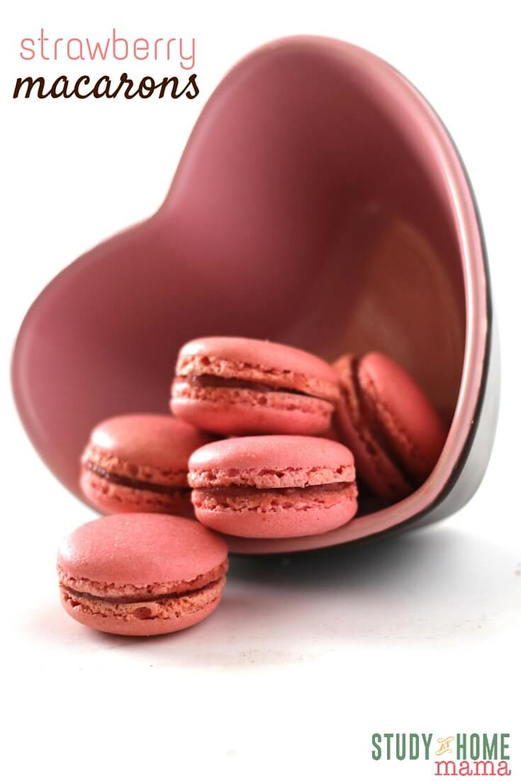Don't miss out on these delicious Stawberry Macarons with their airy, chewy texture inside with a soft crunch exterior. Perfect to make for the love in our life or share them with your kids! Study At Home Mama has special tips to make these yummy macarons turn out just perfect. The perfect Valentine's Day cookie recipe!