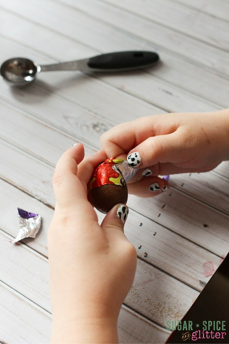 Peeling cream eggs for the cake is a great fine motor activity for kids