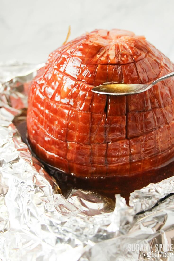Honey-caramel ham recipe - an amazing Easter ham recipe that will convert anyone to a ham-lover! Would you just look at that gorgeous glaze, how is this recipe going to be anything other than amazing with that being poured on it?