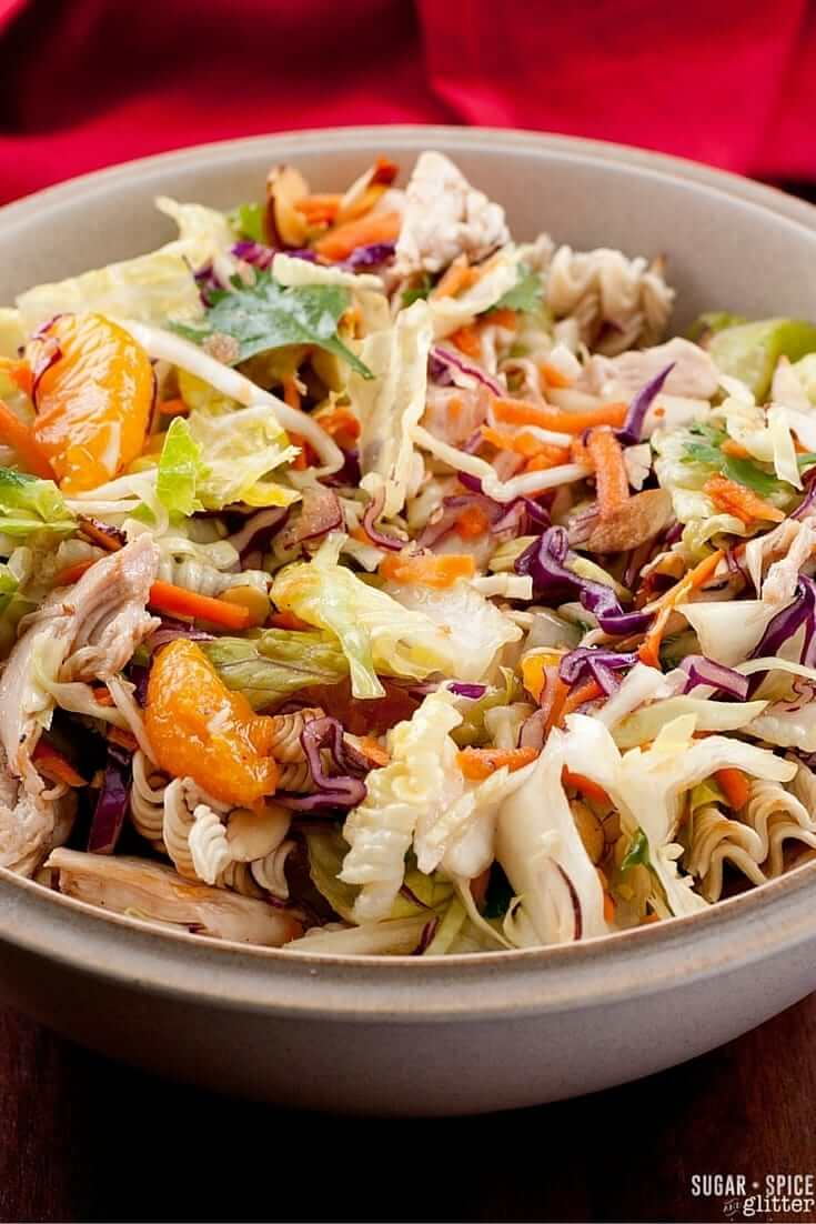 Copycat Wolfgang Puck Salad with cabbage, romaine, baby greens, pickled ginger, cashews, crispy wontons, ginger-sesame vinaigrette
