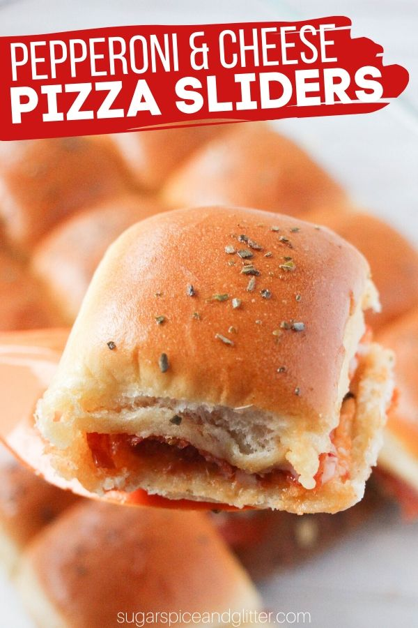 Pepperoni and cheese pizza sliders are the ultimate unique pizza snack for a family movie night or game night - all of the taste of pizza in a cute little slider