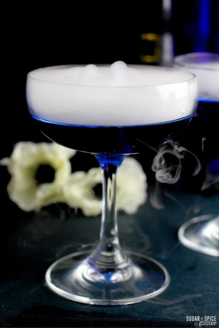 A delicious dry martini with a twist - a color changing twist! This magical color changing martini is the perfect cocktail for a Halloween party or Harry Potter themed party