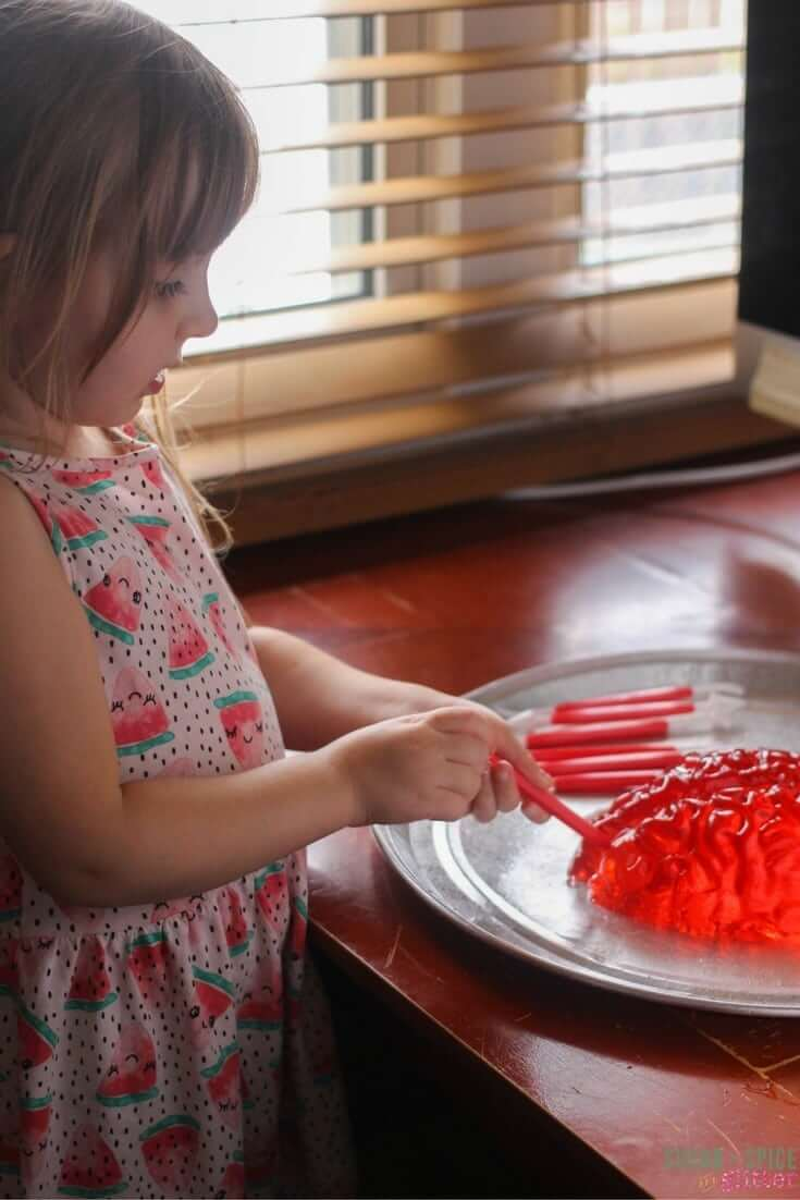 A fun Halloween sensory play activity - dissect a Jell-O brain!
