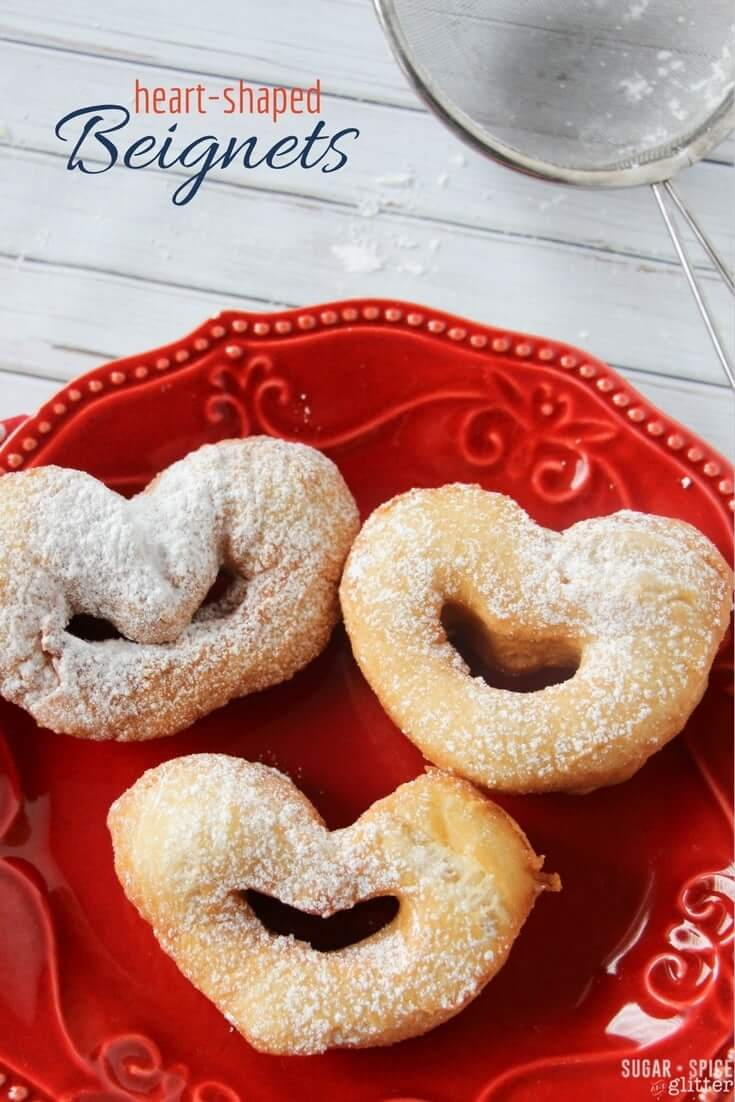Light and crispy on the outside, soft and chewy on the inside and with a light dusting of powdered sugar, these cute heart-shaped beignets are an easy and authentic New Orleans treat perfect for Mardi Gras or for enjoying for a Princess and the Frog movie night
