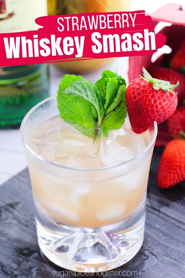 The perfect summer whiskey cocktail, this easy Strawberry Whiskey Smash cocktail tastes just like a strawberry lemonade and is super refreshing on a hot summer day