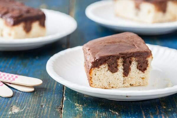 An easy chocolate poke cake with homemade chocolate ganache