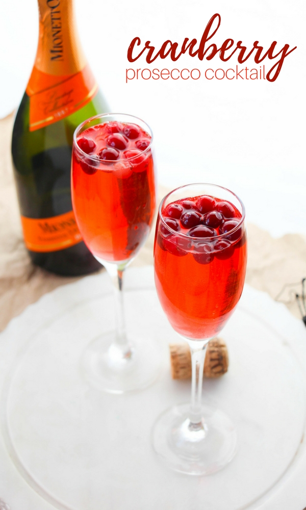 Cranberry Prosecco Cocktail - a fall prosecco punch with a splash of Cointreau and a hint of ginger for a perfectly balanced brunch cocktail recipe