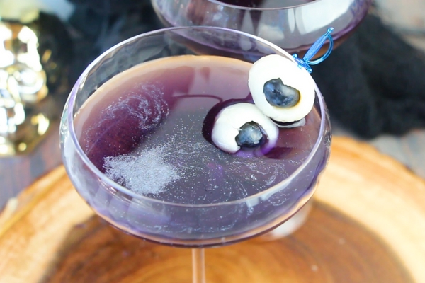 How to make a delicious purple shimmery cocktail recipe with edible fruit eyeballs