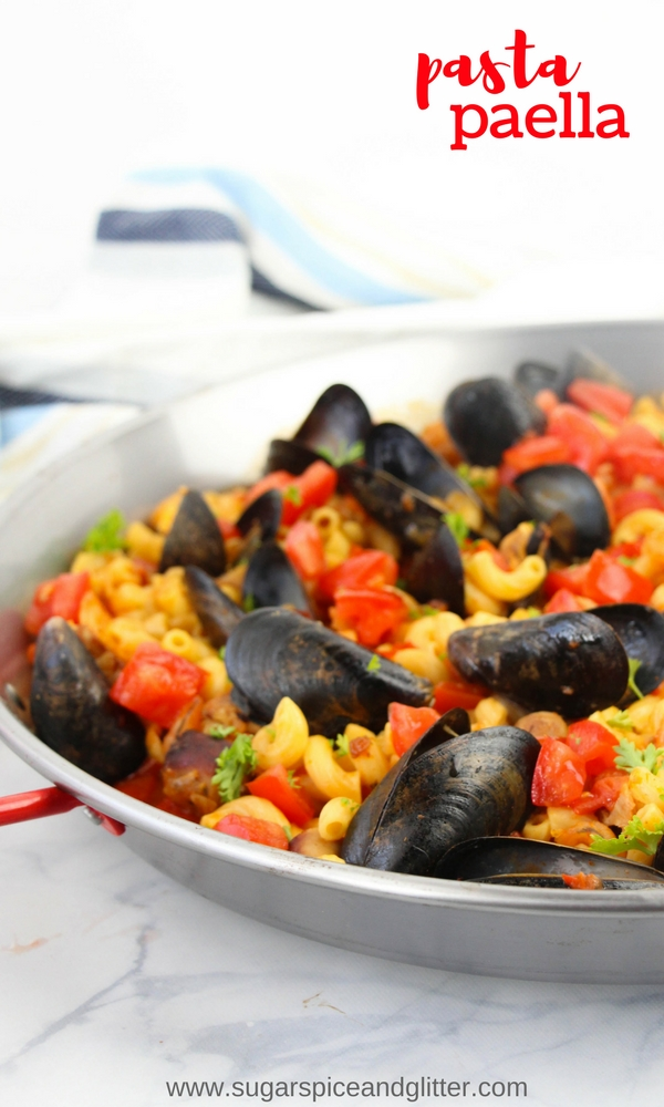 A fun twist on a classic Spanish paella, a Pasta Paella featuring fresh veggies, chicken, sausage, mussels and shrimp - and a good dose of smoked paprika!