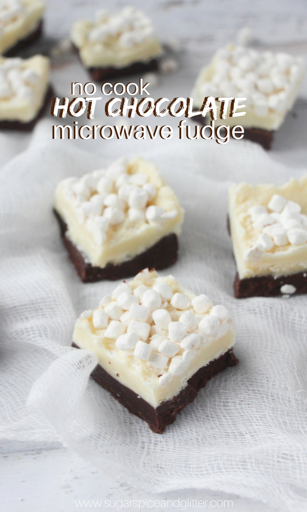 Hot Chocolate Fudge - the perfect homemade fudge recipe. Half white chocolate, half milk chocolate and topped with hot chocolate marshmallows! An easy no-cook recipe kids can make, too!