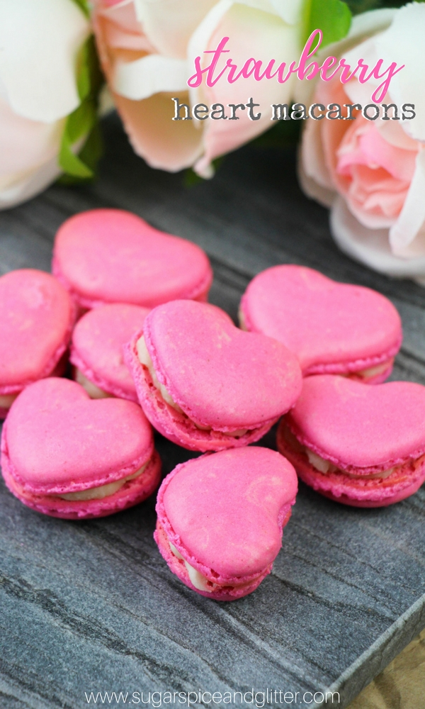 Naturally-flavored Strawberry Heart Macarons with vanilla macaron filling, a fun strawberry cookie recipe for parties or gifts. Sweet for Valentine's Day or Mother's Day dessert