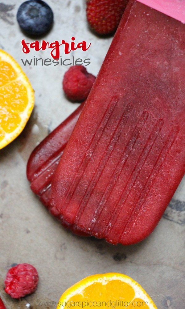 A fun take on a dessert cocktail - these sangria winesicles are fruit-filled wine popsicles just for grown-ups! Our unique recipe actually freezes and doesn't melt as fast as other wine popsicle recipes