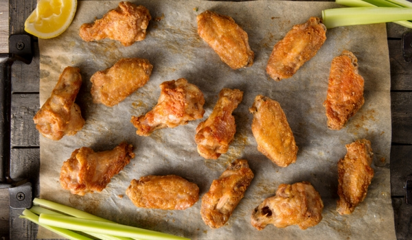 Crispy grilled chicken wings with a homemade honey chipotle sauce, perfect for a game night appetizer