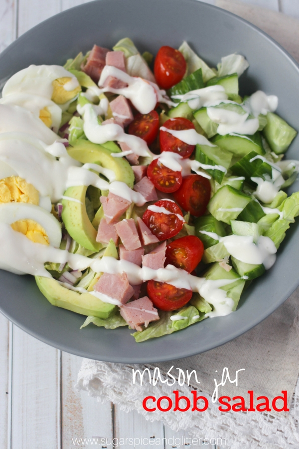 A delicious mason jar cobb salad recipe with a tangy, creamy dressing and plenty of protein and vegetables