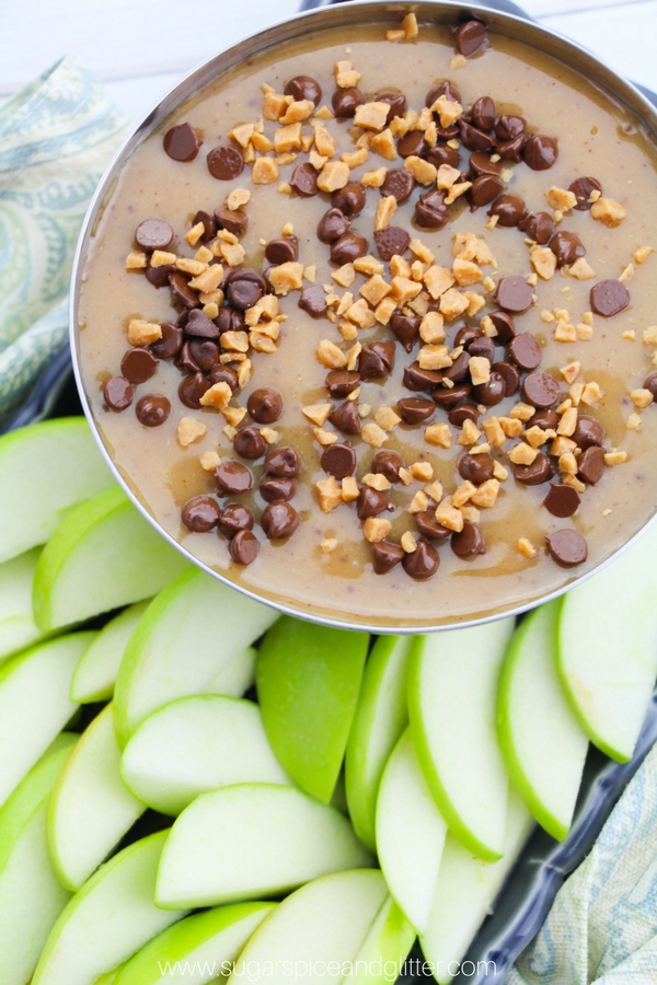 A delicious recipe for homemade caramel fruit dip, sprinkle it with chocolate chips, toffee bits and some flaked sea salt for the ultimate dessert dip