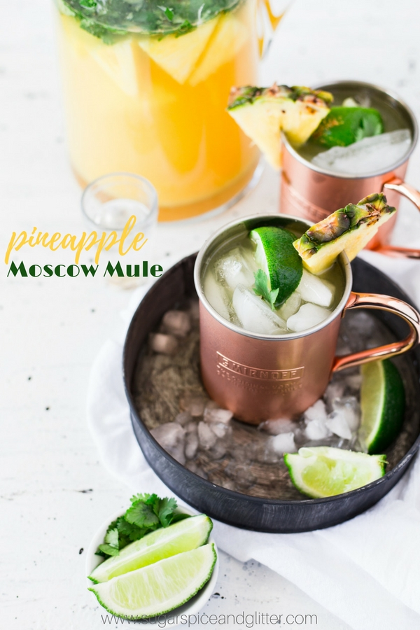 This delicious pineapple vodka cocktail is perfect for summer - a Pineapple Ginger Moscow Mule made with fresh fruit and cilantro