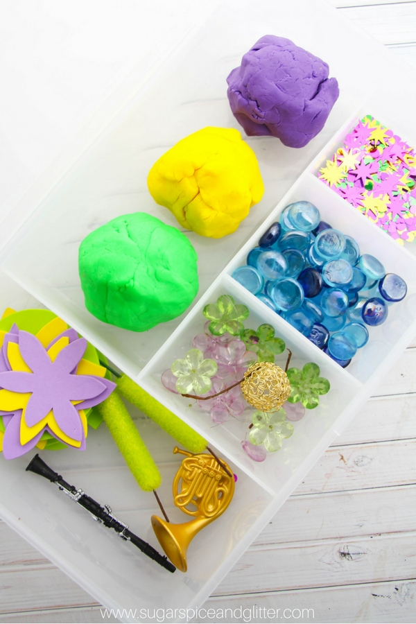 A simple Princess and the Frog homemade play dough kit - a fun Disney sensory play idea with elements from the classic fairy tale