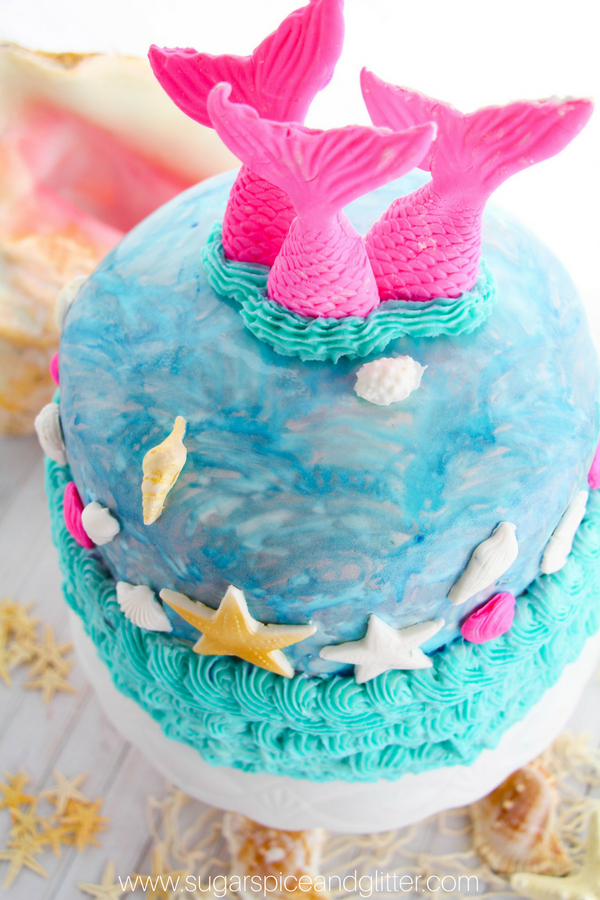 A fun and easy DIY mermaid birthday party cake using a mixture of fondant and buttercream icing. This cake is easy enough for beginners but looks professional