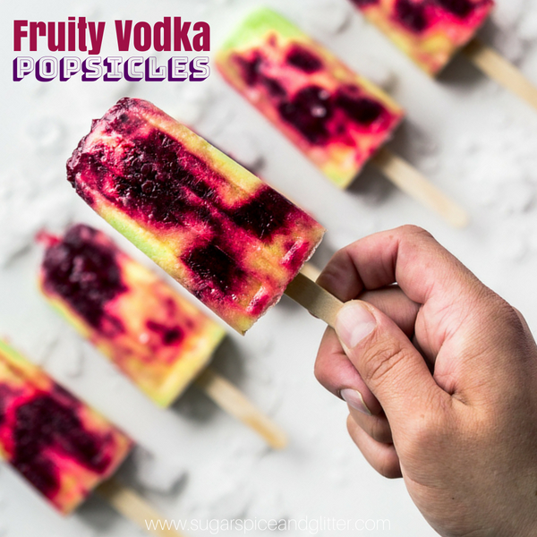 An alcoholic popsicle recipe using vodka, these fruity popsicles taste like a creamy berry-spiked pina colada