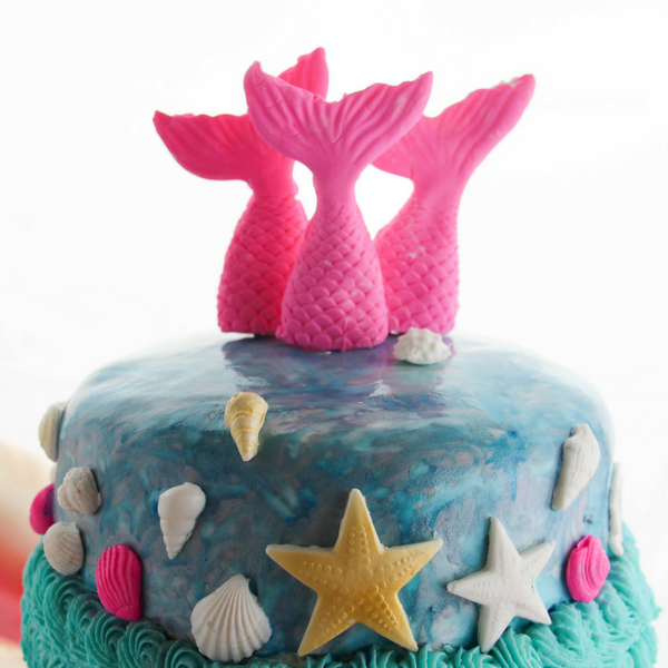 How magical is this DIY mermaid cake?! A fondant and buttercream mermaid cake perfect for a mermaid birthday party