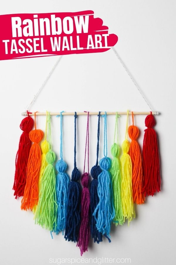This easy step-by-step tutorial (including a how-to video) walks you through how to make yarn tassels that can be used to make a gorgeous rainbow wall decor piece, perfect for parties, kids' rooms or adding to a window treatment.