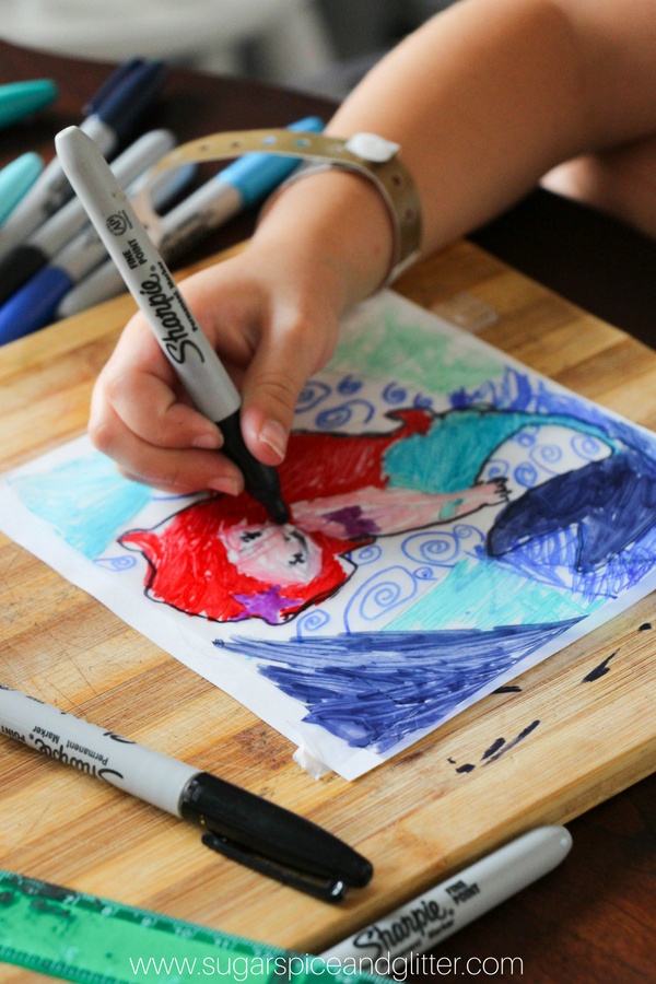 Grab your free printable for our easy 5-minute MERMAID CRAFT to bring some color to your windows on a rainy day