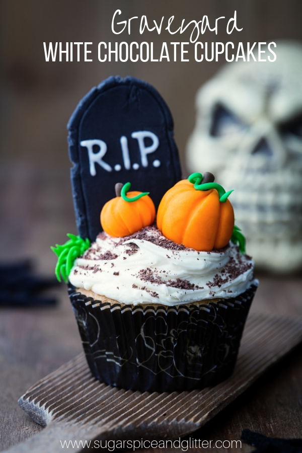 Spooky Halloween Cupcakes with fondant tombstones and pumpkins. White chocolate cupcakes with white chocolate buttercream frosting