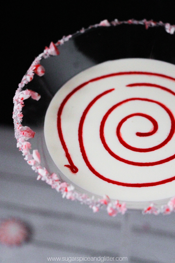 How cute is this fun Peppermint Martini with candy cane rim and candy swirl?!