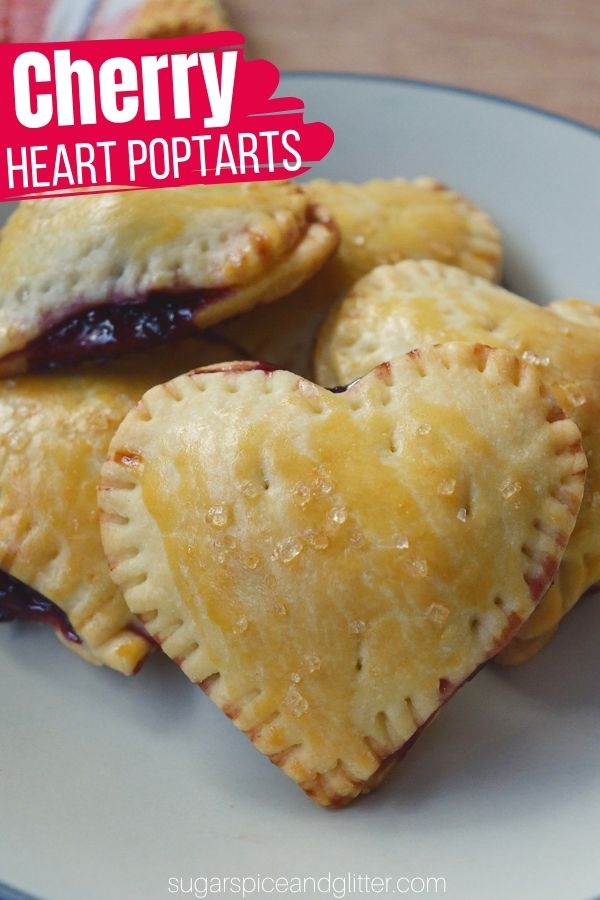Buttery, flakey cherry hand pies in a fun heart-shape, perfect for anniversaries or Valentine's Day. This simple 4-ingredient recipe is easy enough for kids to make, too!