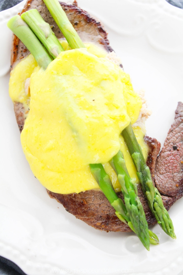 A simple panseared steak recipe topped with crab meat, asparagus and buttery bearnaise sauce