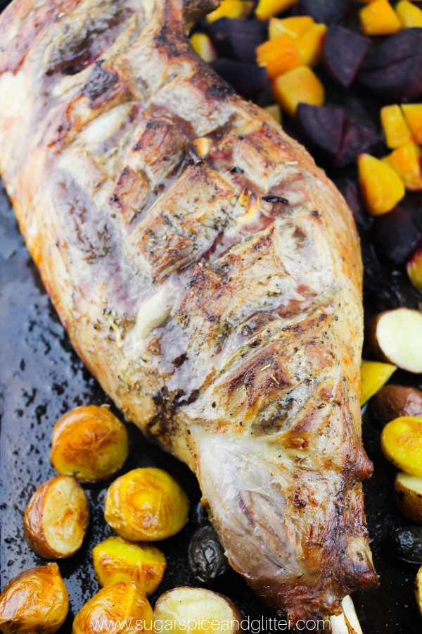 The Best leg of lamb recipe - roast leg of lamb with garlic and Italian seasonings served with mini potatoes and roasted beets
