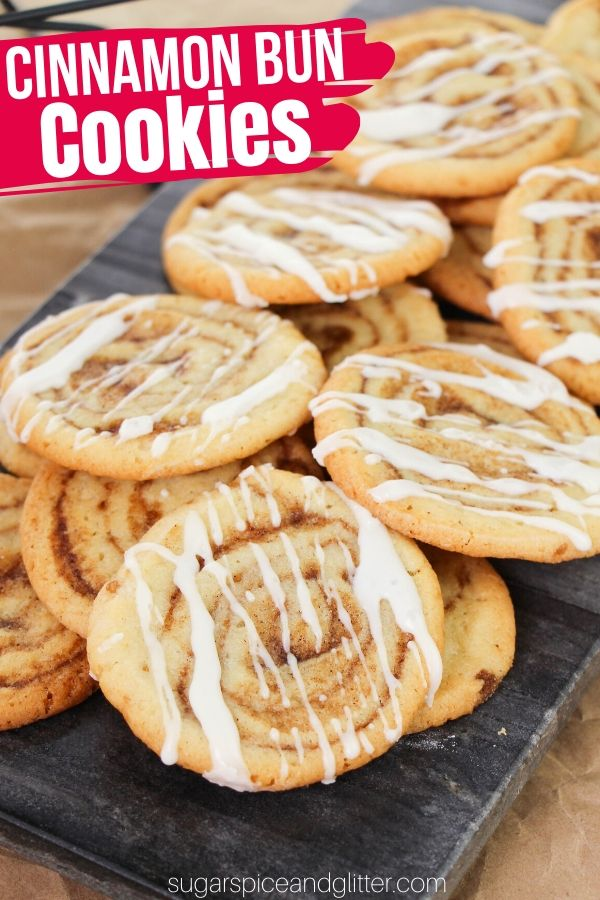 A delicious twist on cinnamon buns, these Cinnamon Bun Sugar Cookies are tender, melt-in-your-mouth vanilla cookies with a cinnamon-brown sugar swirl baked right in. A perfect baking activity to do with the kids!