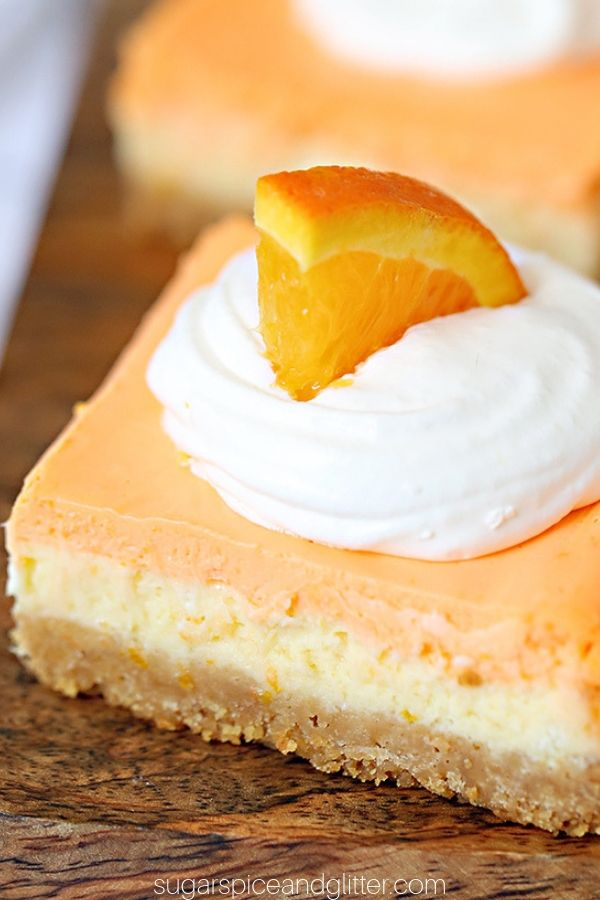 If you love Creamsicles, you're going to go crazy for this No-Bake Orange Cheesecake Bars recipe. No-Bake Creamsicle Cheesecake is the perfect party food