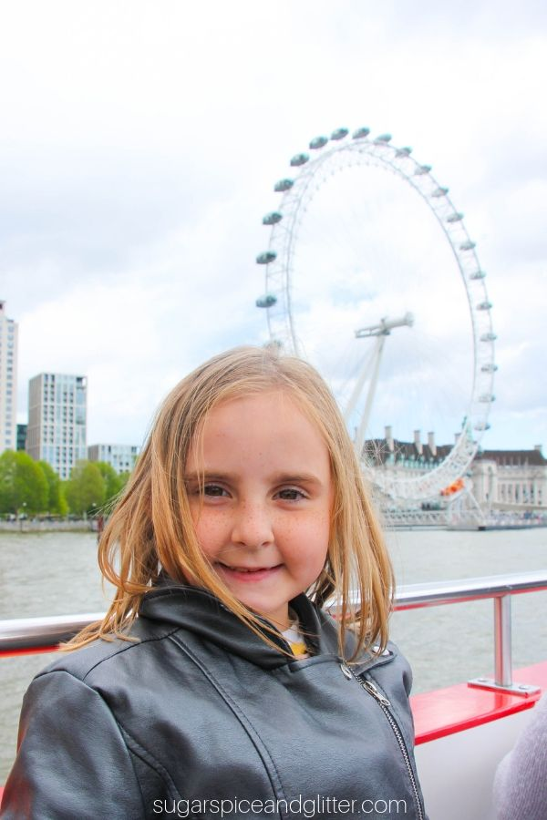 Riding a boat down the Thames River and seeing the London Eye, with the London Pass
