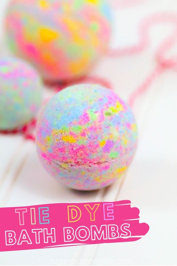 A colorful and fun bath bomb perfect for summer crafting, this Tie Dye Bath Bomb makes a gorgeous addition to your bath - or a fun homemade gift!