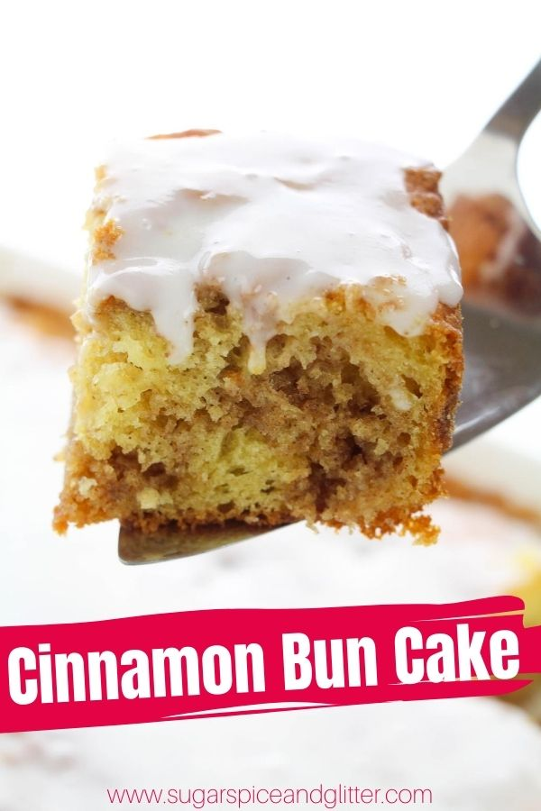 A scrumptious and tender cinnamon bun cake with swirls of sweet cinnamon sugar, crackly vanilla frosting glaze and all of the flavor of a traditional cinnamon bun - without all the work! This easy sheet cake is the perfect potluck dessert