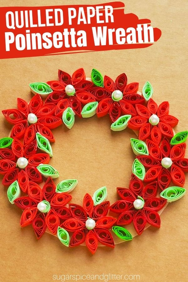 A gorgeous quilled paper Christmas ornament, this quilled paper poinsettia wreath can be hung on the wall, made into an ornament or used to decorate a Christmas card.