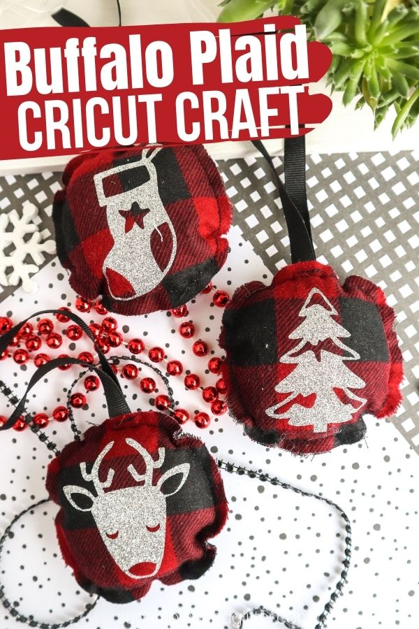 A step-by-step tutorial for how to make rustic Christmas fabric ornaments using your Cricut machine. We used buffalo plaid fabric and glitter heat transfer vinyl for a fun and unique Cricut Christmas Ornament.