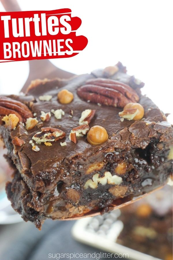 A decadent and rich Turtles brownie recipe you simply must eat with a fork! These brownies are packed with pecans, caramel and chocolate and then topped with an easy and quick boiled chocolate frosting