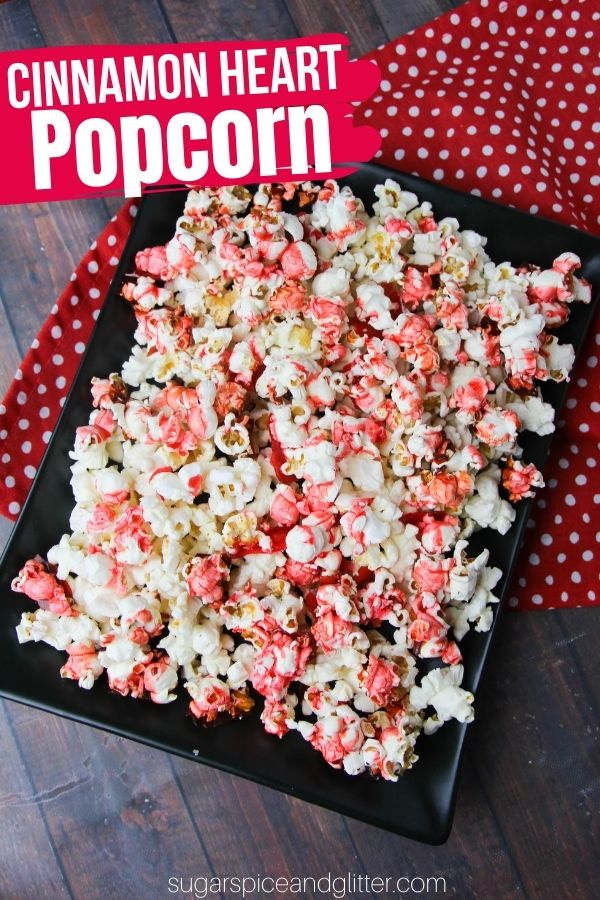 A delicious candied popcorn recipe using cinnamon heart candies. The perfect movie night snack for Valentine's Day, or a fun classroom treat. This cinnamon heart popcorn is only 3-ingredients and a delicious treat for the cinnamon heart fans in your family.