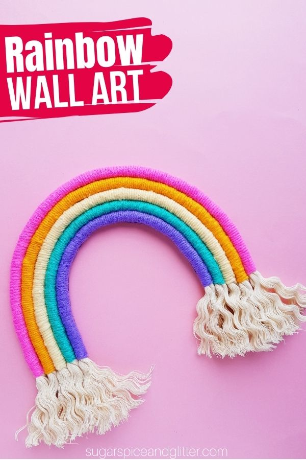 A fun DIY Rainbow Wall Hanging inspired by macrame, this yarn and rope rainbow adds a pop of color and a touch of whimsy to your decor, while also adding warmth and texture.