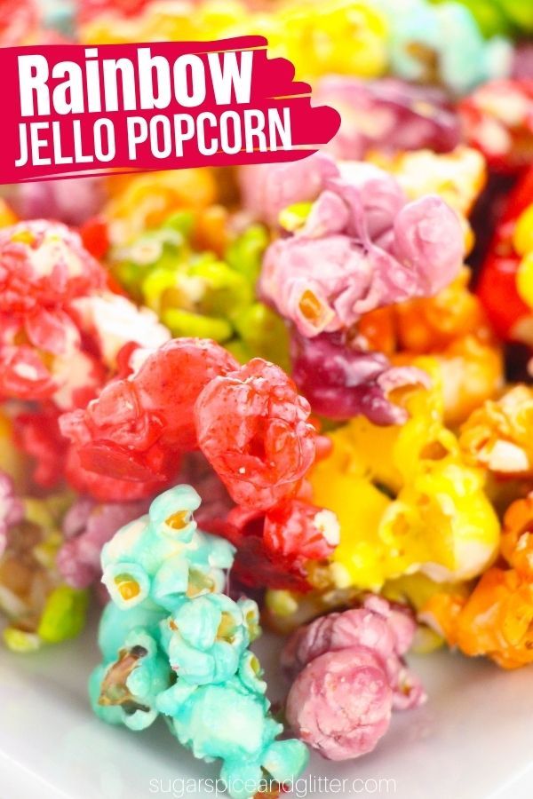 This Rainbow Jello Popcorn is a fun, fruity candied popcorn recipe perfect for parties, bake sales or family movie nights. It's super simple to make and this recipe makes a LOT of popcorn, which you're going to want because this stuff is seriously good.