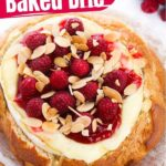 Baked Brie in Sourdough Bread with Raspberries and Toasted Almonds (with Video)