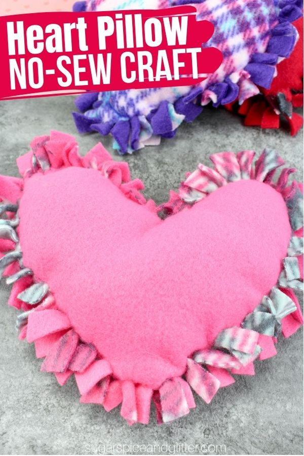 A fun no-sew craft for kids to make their own heart shaped pillows. This easy 20 minute craft is perfect for a sleepover or Valentine's day party and is a great way to teach kids how to tie knots.